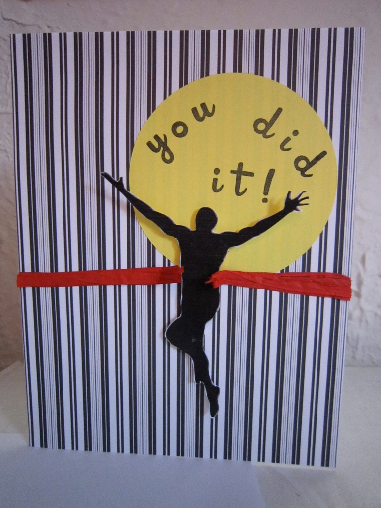 """Card with a runner breaking through the ribbon and the message, """"You did it!"""""""