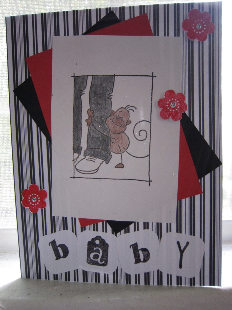 "Contemporary white, black, and red ""welcome, baby"" card"