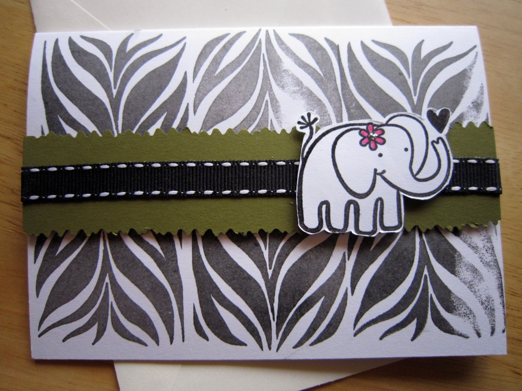 zebra-patterned birthday card with a jumbo elephant