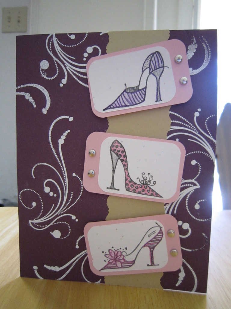 Card with three pairs of high-heeled shoes