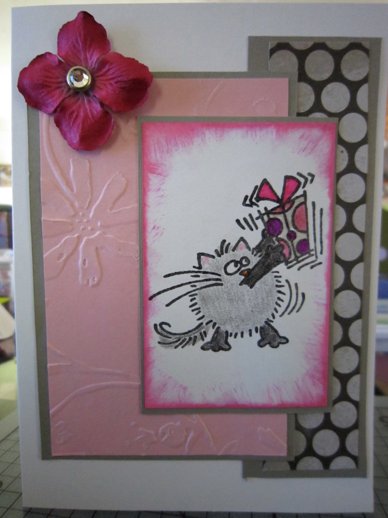 gray and pink layered card with image of cat shaking a present
