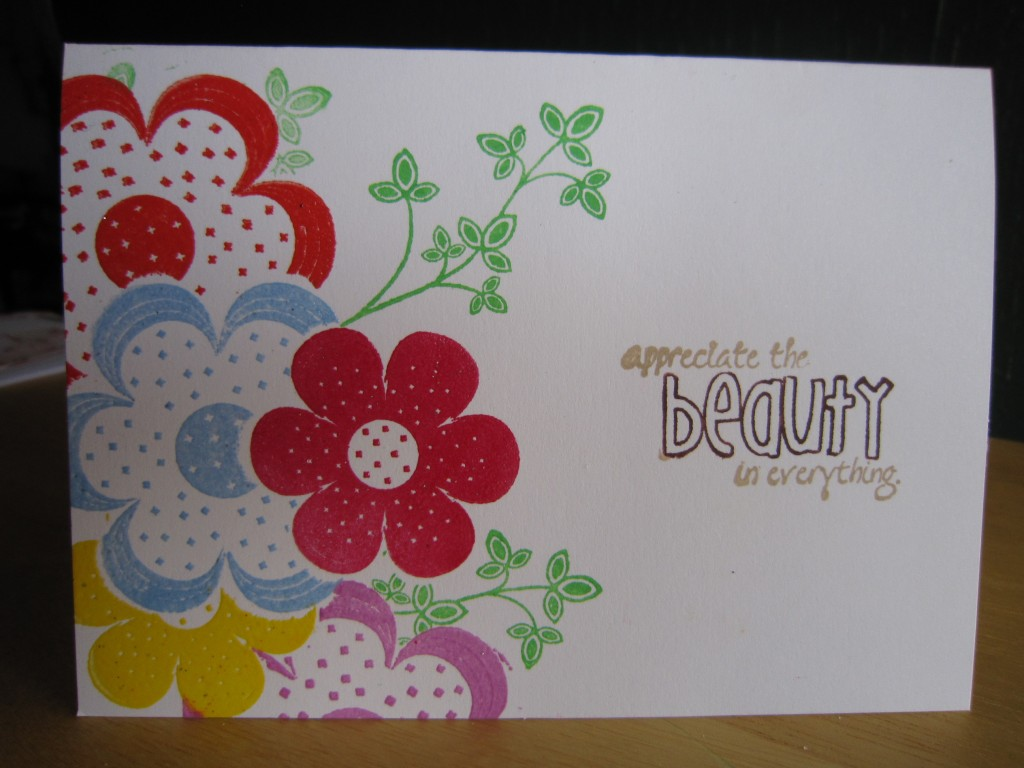 "a card with colorful blossoms and the sentiment, ""appreciate the beauty in everything"""