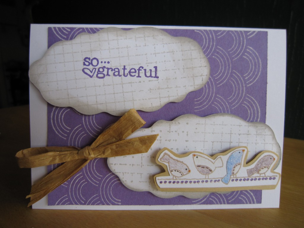 a purple and white card with four birdies and the message, so grateful